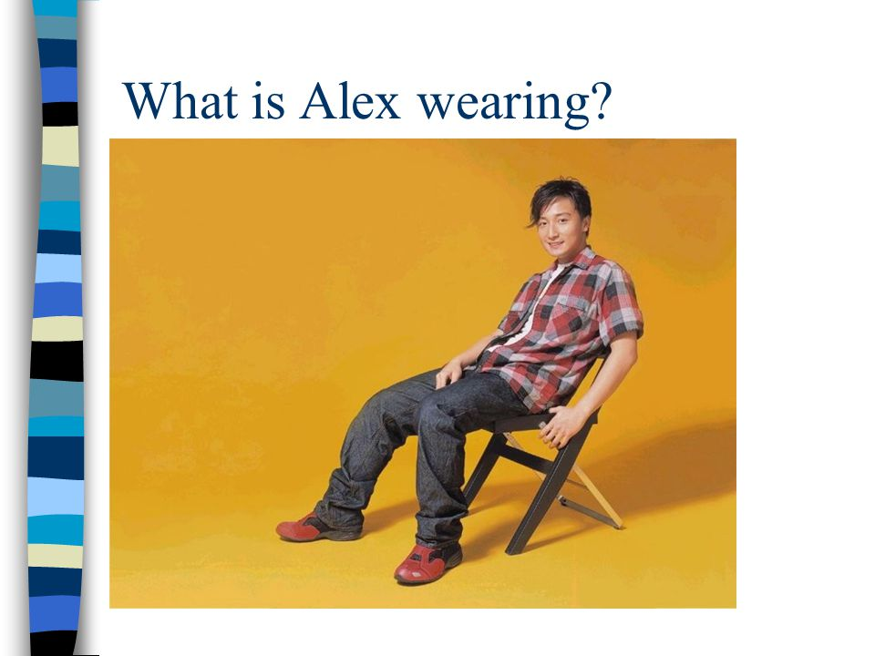 Alex is wearing... a red and black shirt, jeans and red trainers.