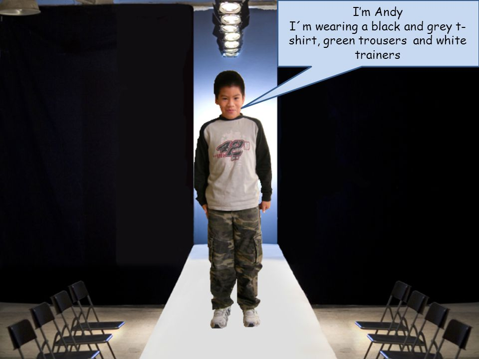 Im Andy I´m wearing a black and grey t- shirt, green trousers and white trainers