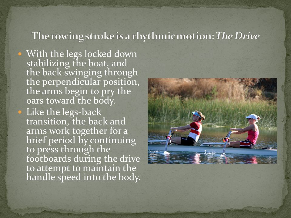 With the legs locked down stabilizing the boat, and the back swinging through the perpendicular position, the arms begin to pry the oars toward the body.