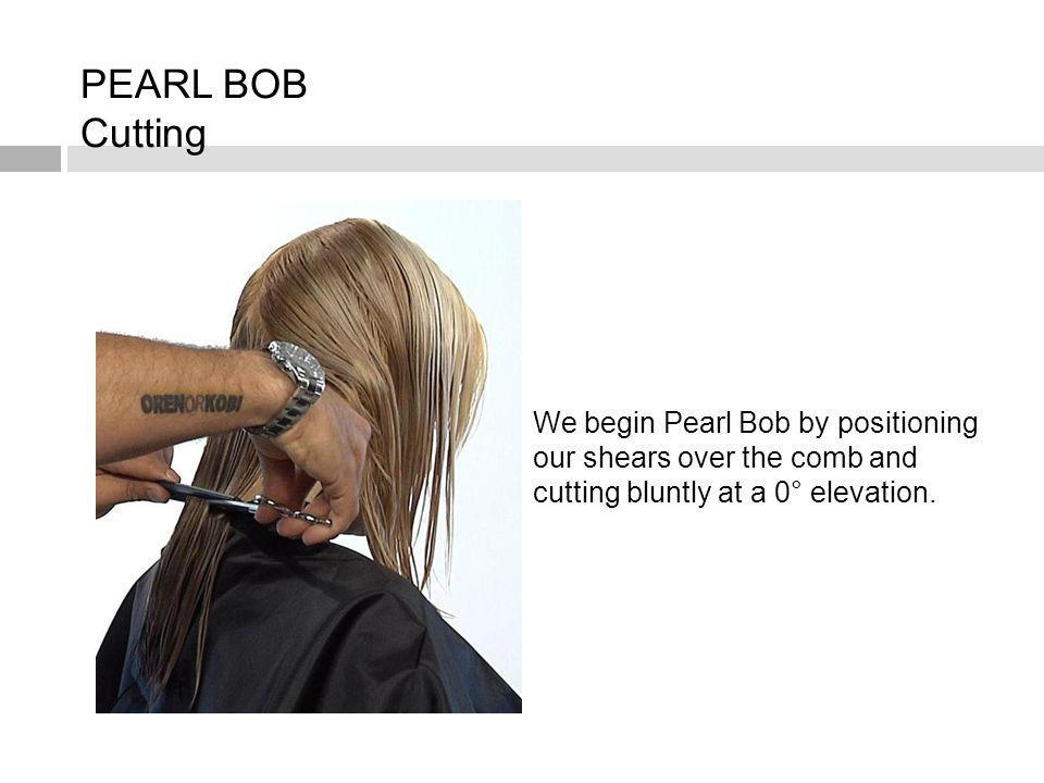 We begin Pearl Bob by positioning our shears over the comb and cutting bluntly at a 0° elevation.