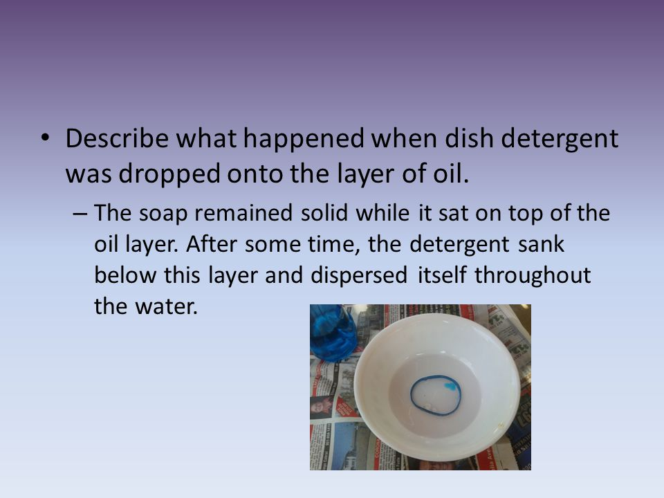 Describe what happened when dish detergent was dropped onto the layer of oil.