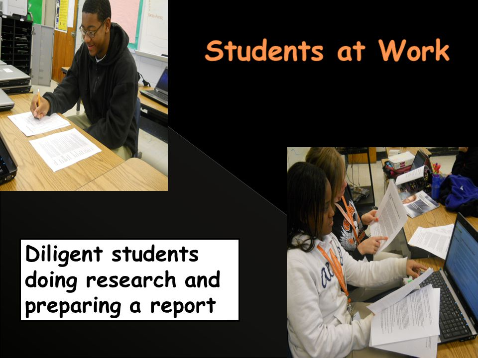 Diligent students doing research and preparing a report