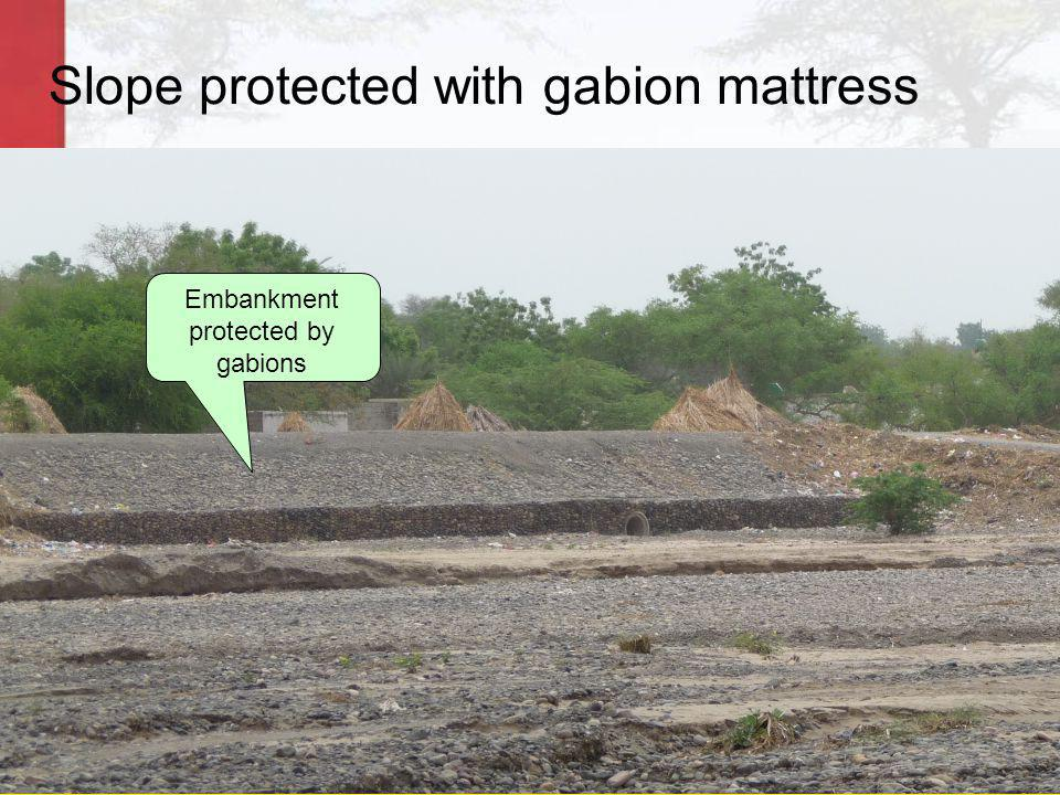 Slope protected with gabion mattress Embankment protected by gabions