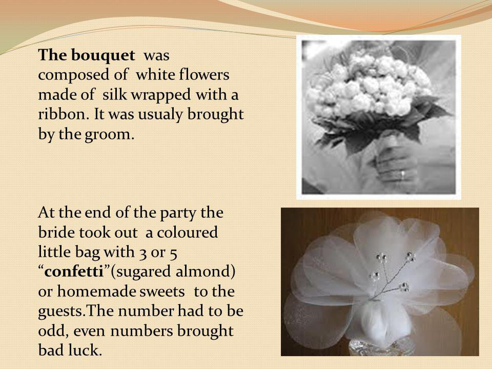 The bouquet was composed of white flowers made of silk wrapped with a ribbon.