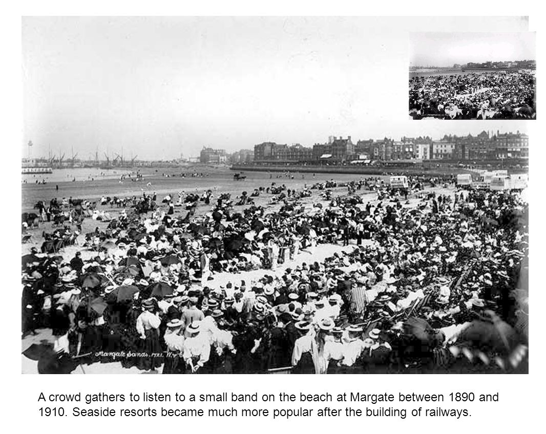 A crowd gathers to listen to a small band on the beach at Margate between 1890 and 1910.