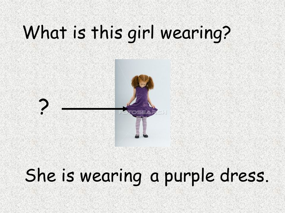 What is this girl wearing? She is wearing … ? a purple dress.