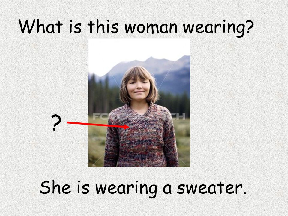 She is wearing a sweater. What is this woman wearing? ?
