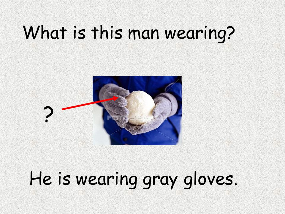 He is wearing gray gloves. What is this man wearing? ?