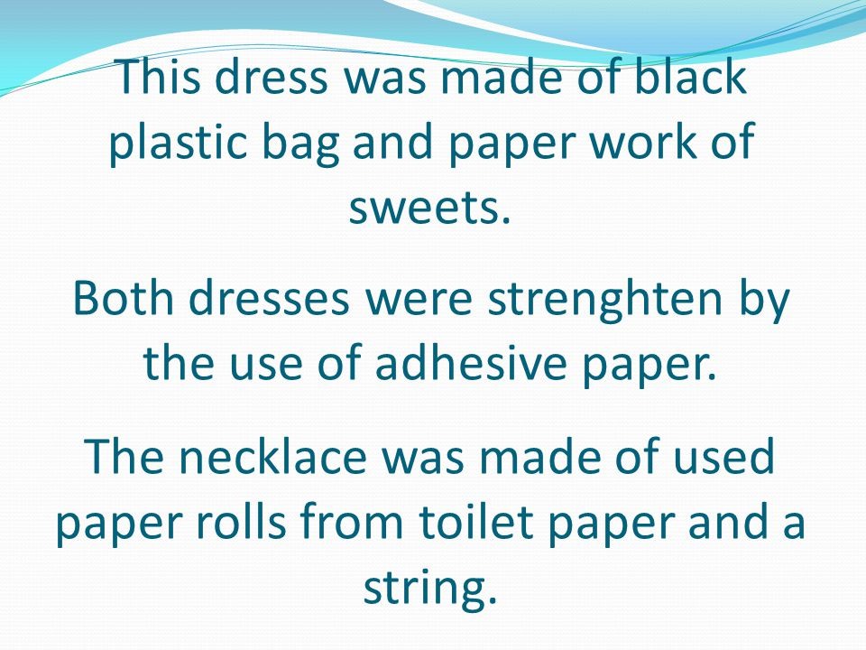 This dress was made of black plastic bag and paper work of sweets.
