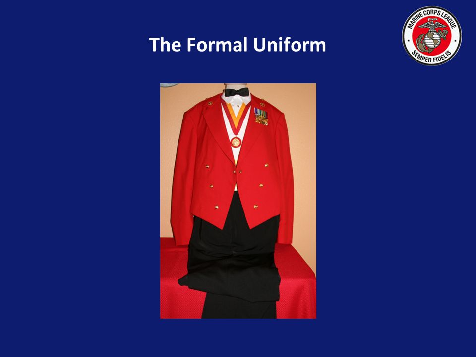 The red mess jacket is worn with this uniform, but the red blazer may be worn as an option, due to the high cost of the red mess jacket, which is orde