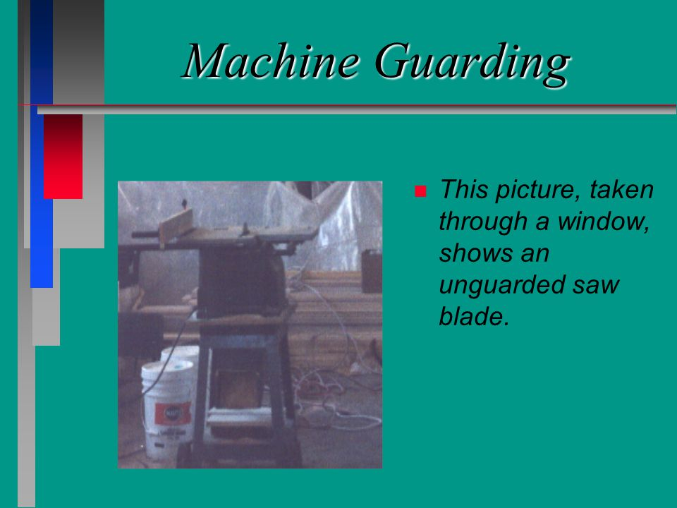 Machine Guarding n n This picture, taken through a window, shows an unguarded saw blade.