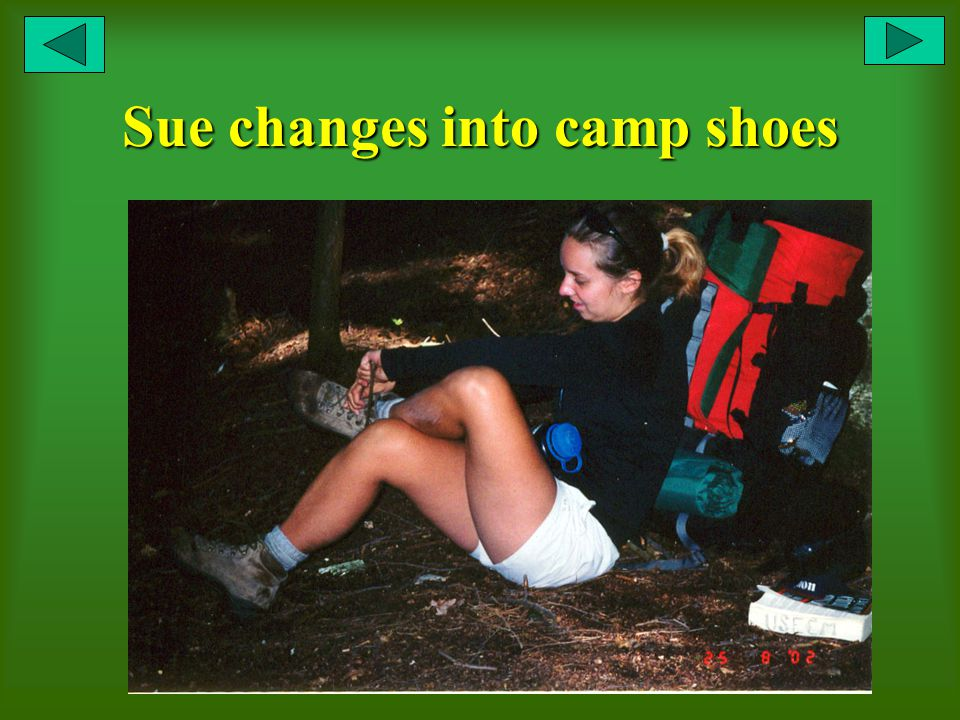 Sue changes into camp shoes