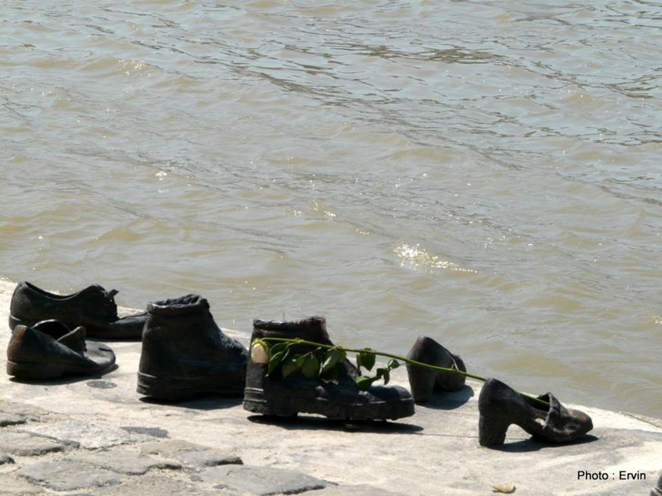 Shoes on the Danube Promenade Budapest The monument,a row of about 40 metres long, consists of 60 pairs of iron shoes, created by the sculptor Gyula P