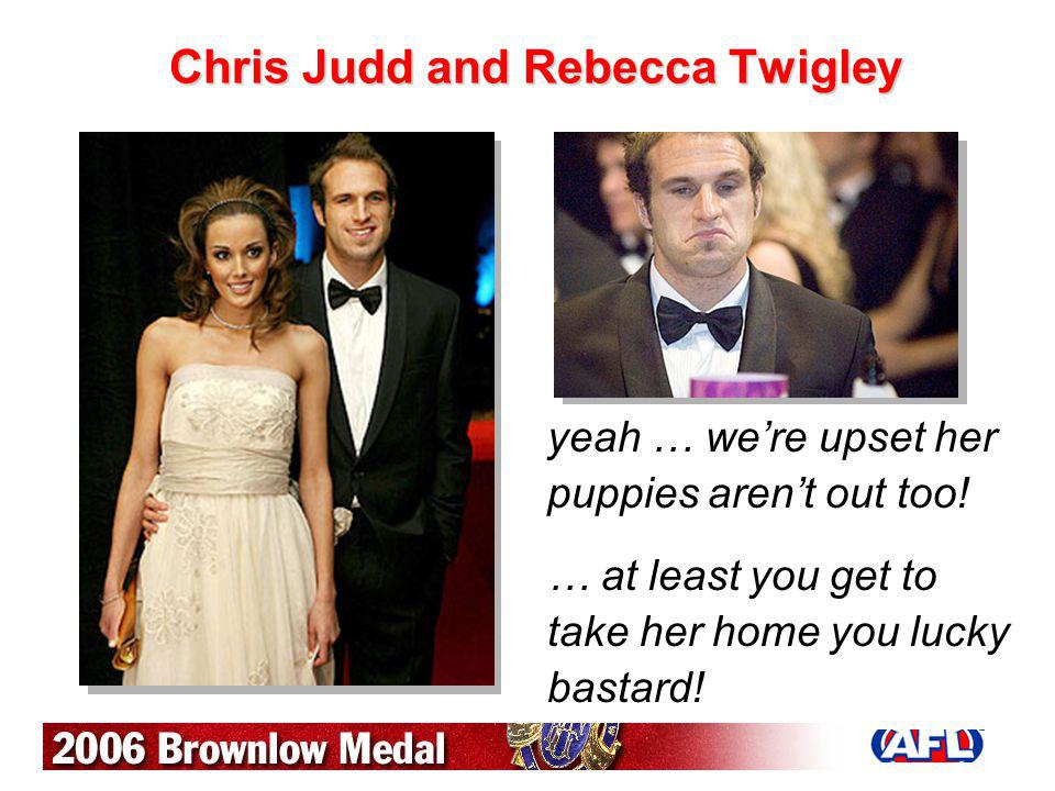 Chris Judd and Rebecca Twigley yeah … were upset her puppies arent out too! … at least you get to take her home you lucky bastard!