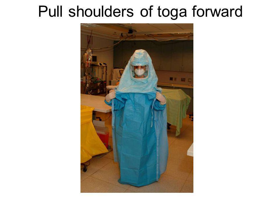 Pull shoulders of toga forward