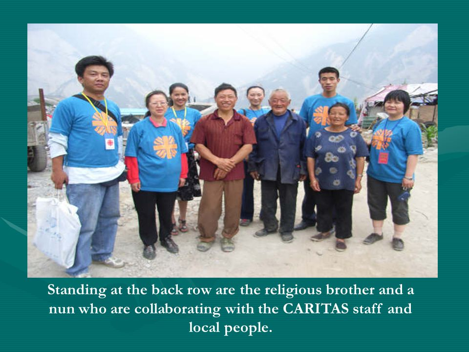 Standing at the back row are the religious brother and a nun who are collaborating with the CARITAS staff and local people.