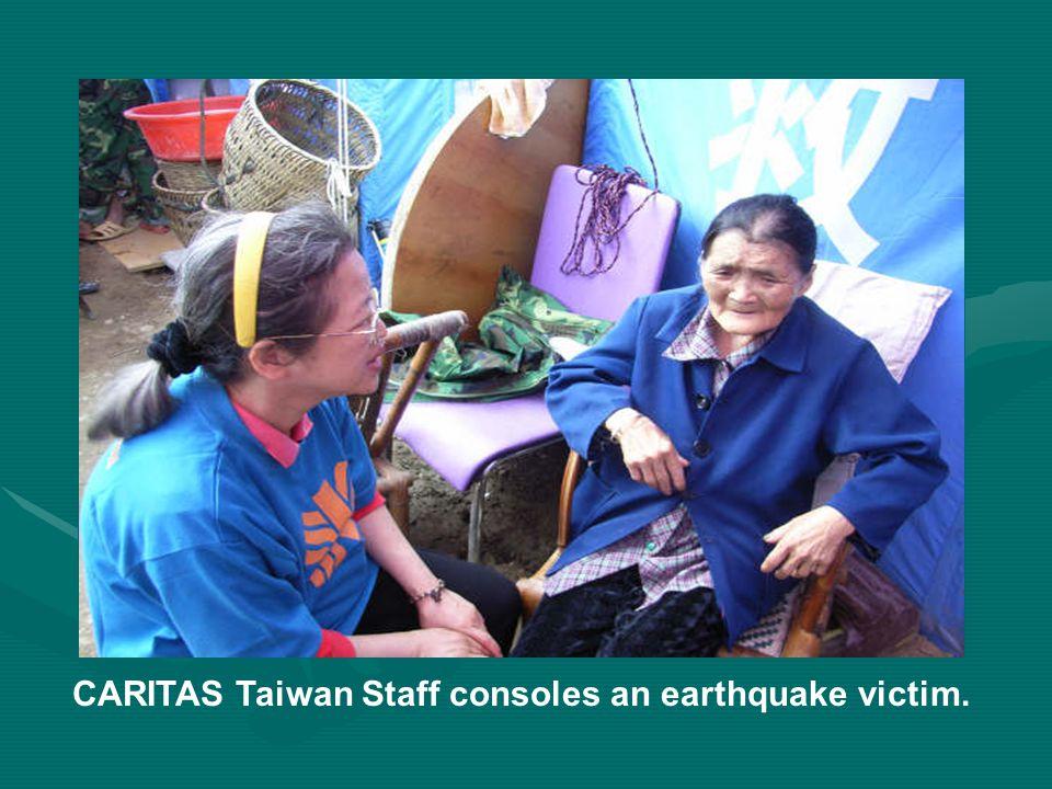CARITAS Taiwan Staff consoles an earthquake victim.