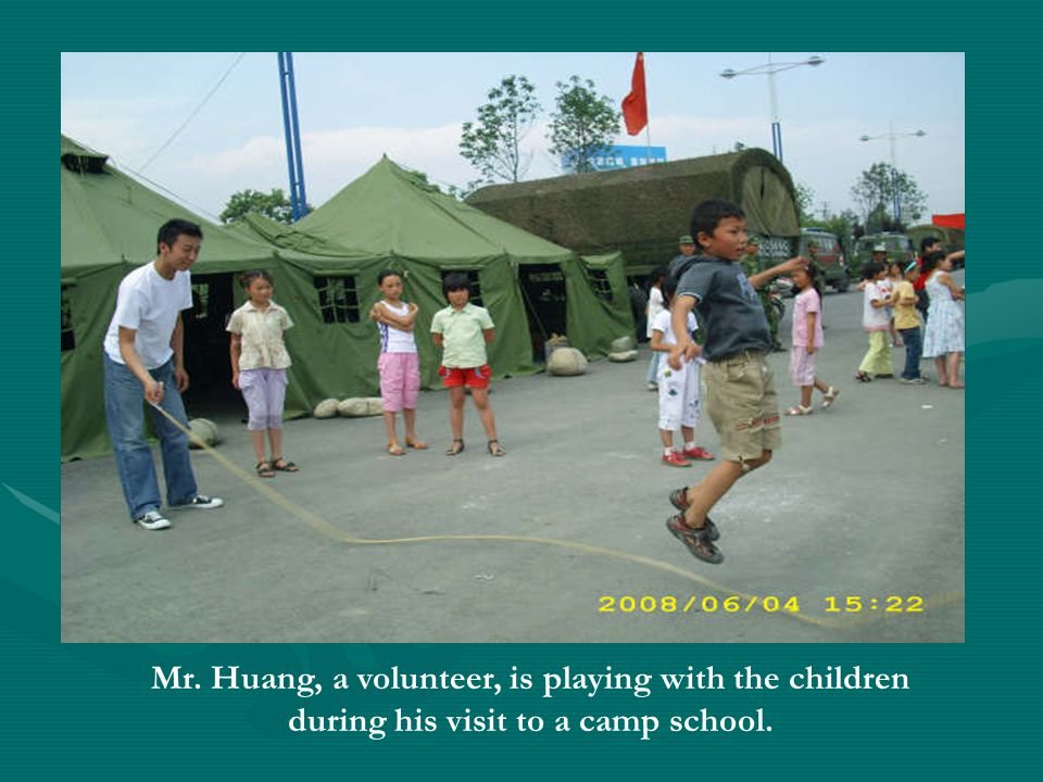Mr. Huang, a volunteer, is playing with the children during his visit to a camp school.