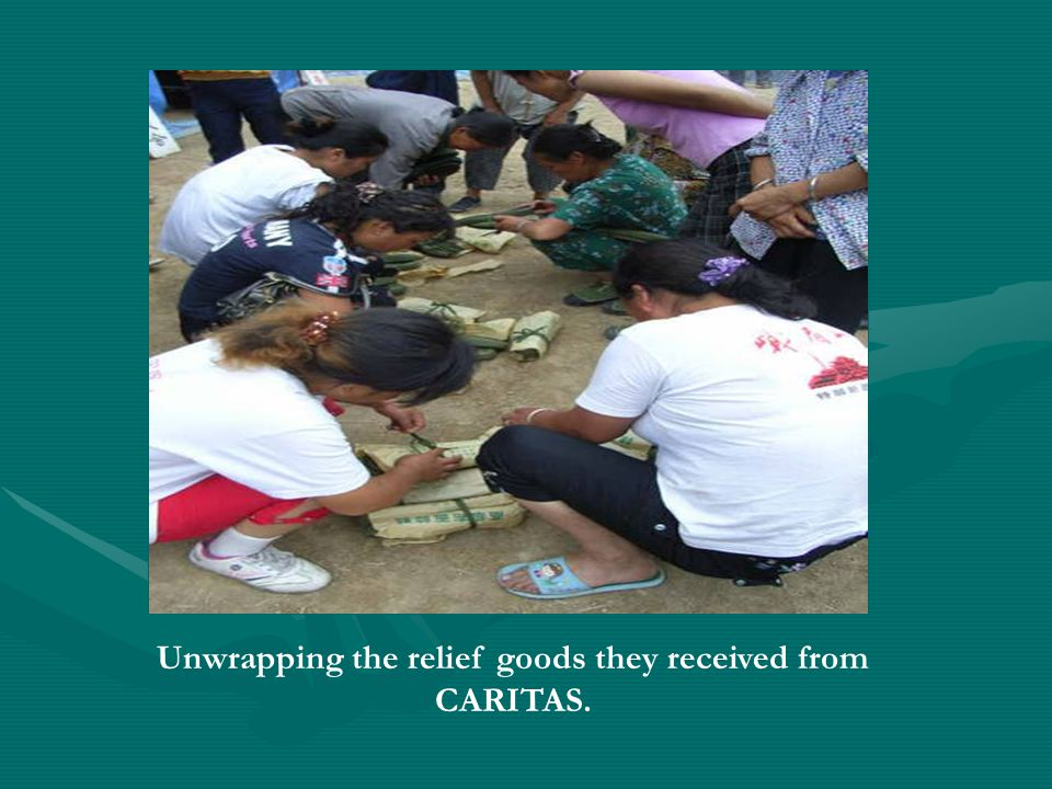 Unwrapping the relief goods they received from CARITAS.