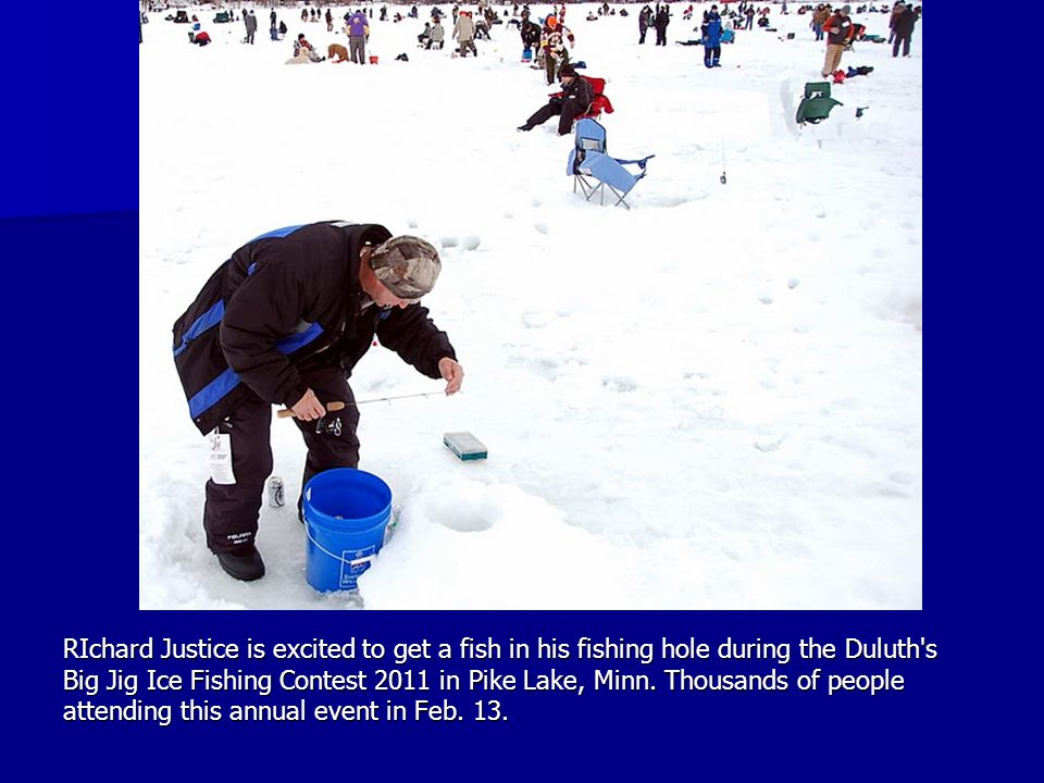 RIchard Justice is excited to get a fish in his fishing hole during the Duluth's Big Jig Ice Fishing Contest 2011 in Pike Lake, Minn. Thousands of peo