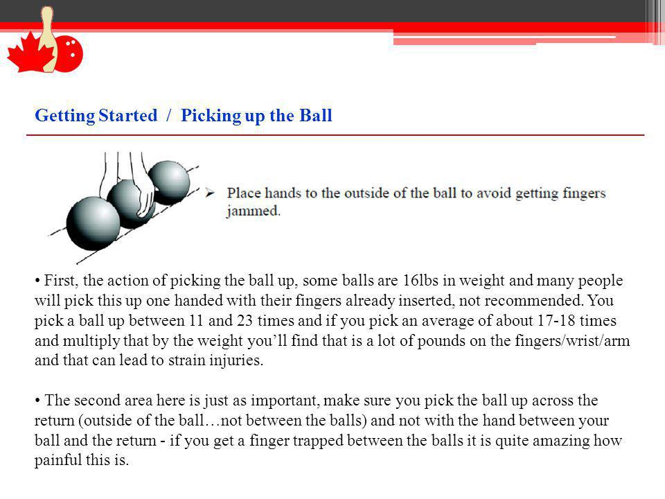 Pick the ball up two handed without inserting the fingers, do this while holding the ball cradled in the opposite arm.