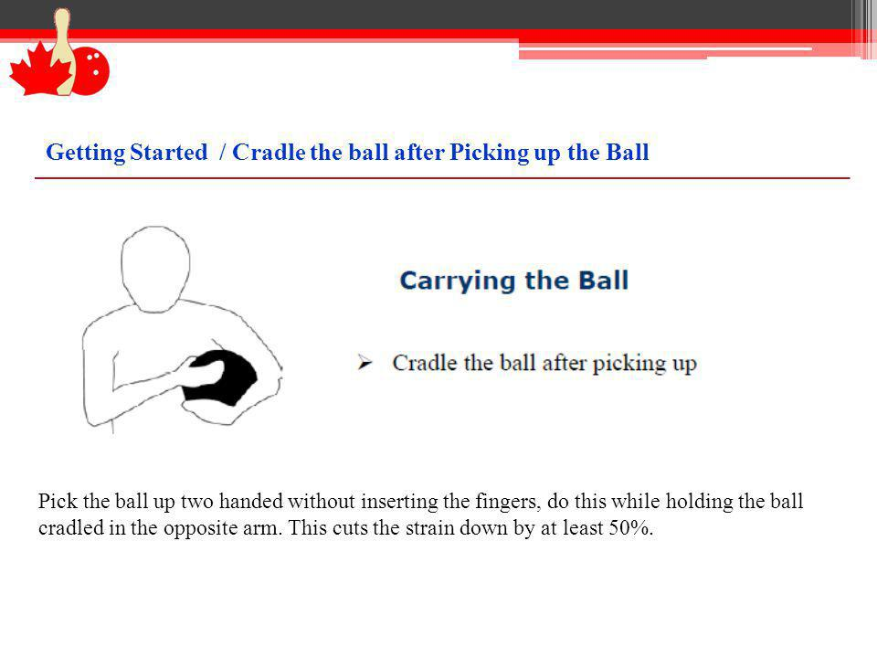 Pick the ball up two handed without inserting the fingers, do this while holding the ball cradled in the opposite arm. This cuts the strain down by at