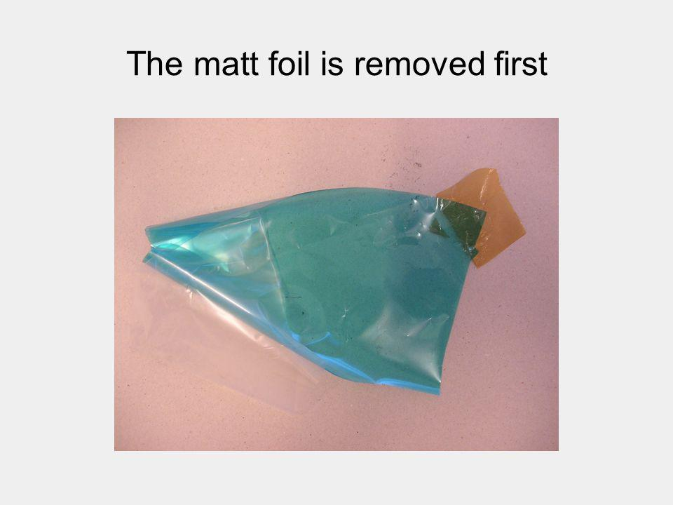 The matt foil is removed first