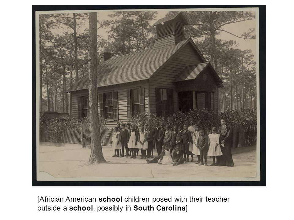 [Africian American school children posed with their teacher outside a school, possibly in South Carolina]