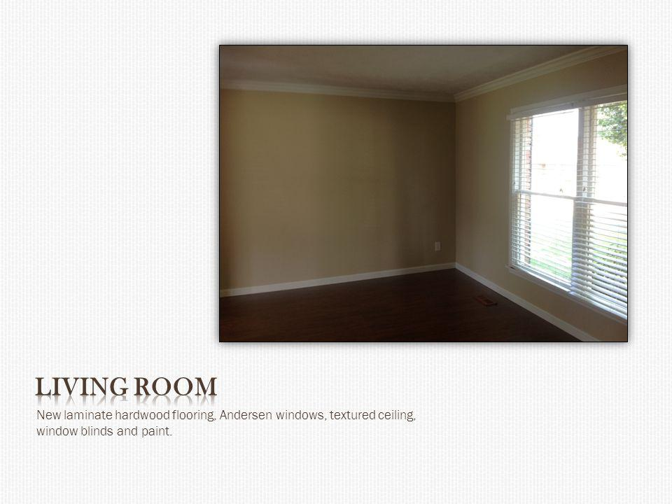 New laminate hardwood flooring, Andersen windows, textured ceiling, window blinds and paint.