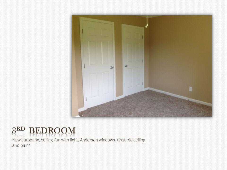New carpeting, ceiling fan with light, Andersen windows, textured ceiling and paint.