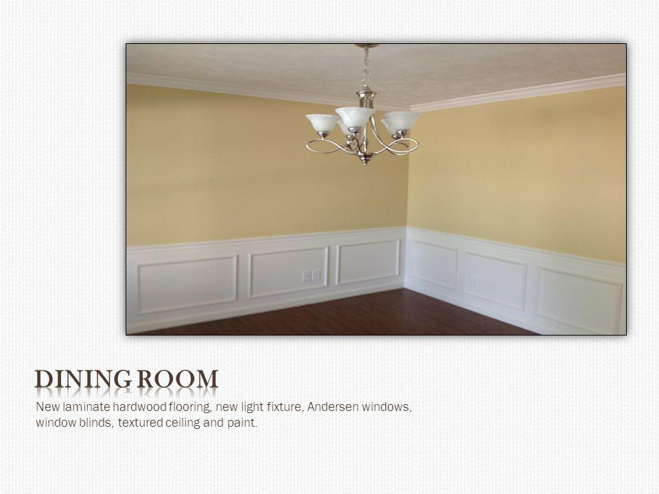 New laminate hardwood flooring, new light fixture, Andersen windows, window blinds, textured ceiling and paint.