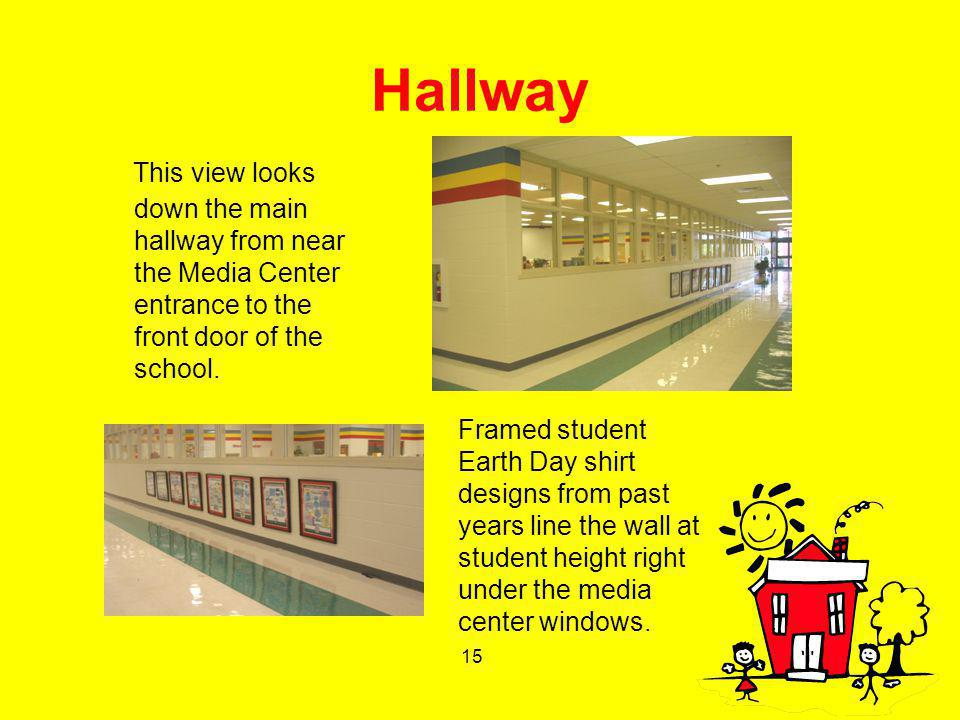 15 Hallway This view looks down the main hallway from near the Media Center entrance to the front door of the school. Framed student Earth Day shirt d