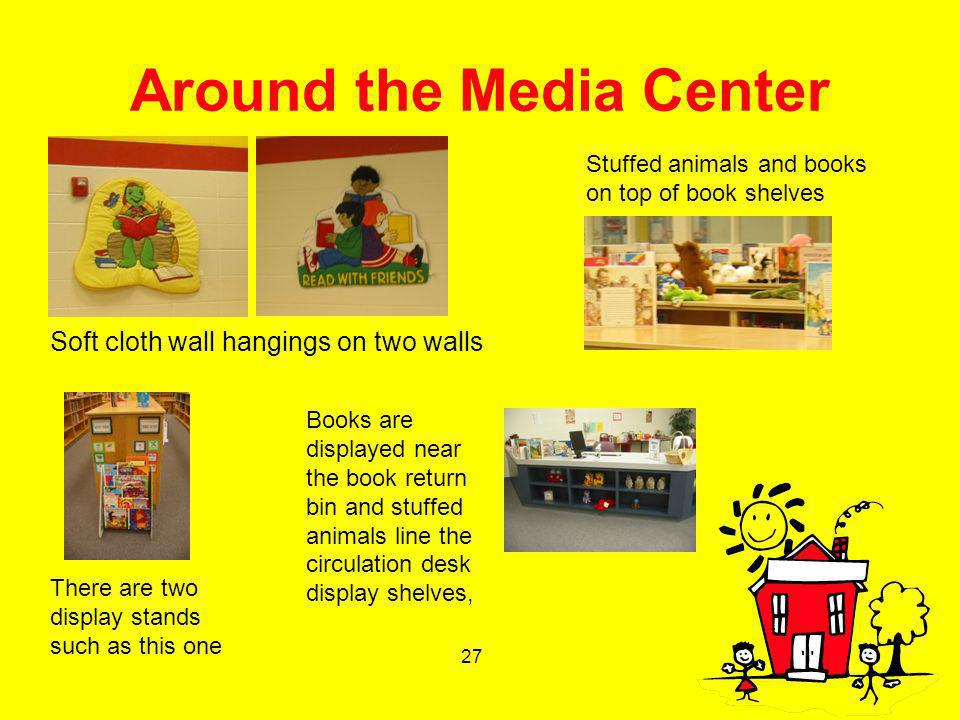 27 Around the Media Center Soft cloth wall hangings on two walls Stuffed animals and books on top of book shelves There are two display stands such as