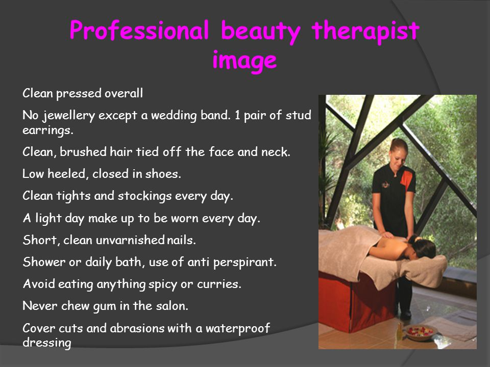 Professional beauty therapist image Clean pressed overall No jewellery except a wedding band.