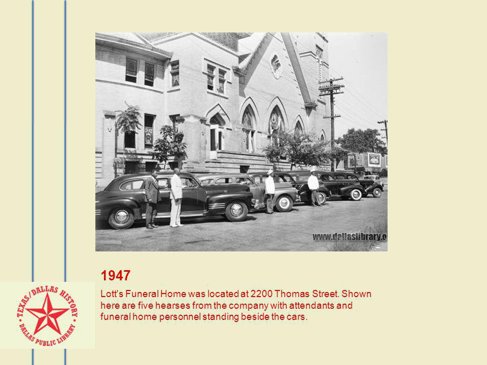 1947 Lott's Funeral Home was located at 2200 Thomas Street. Shown here are five hearses from the company with attendants and funeral home personnel st