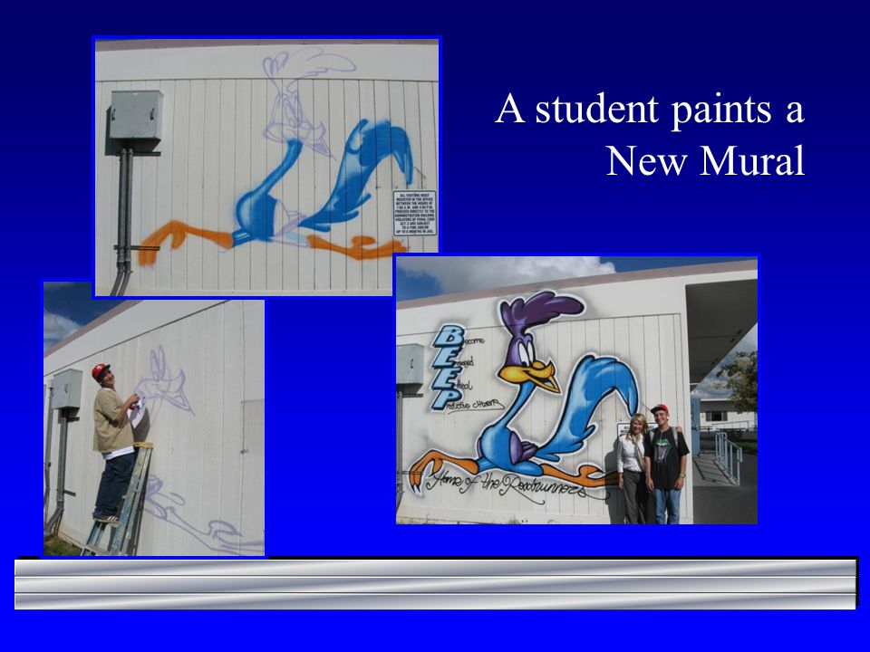A student paints a New Mural