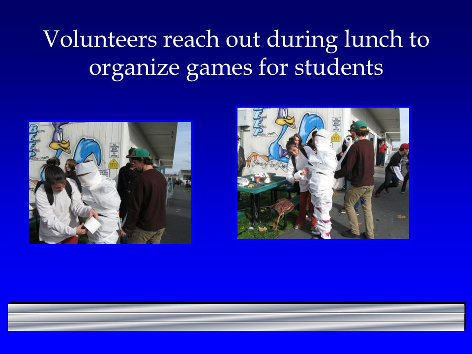 Volunteers reach out during lunch to organize games for students