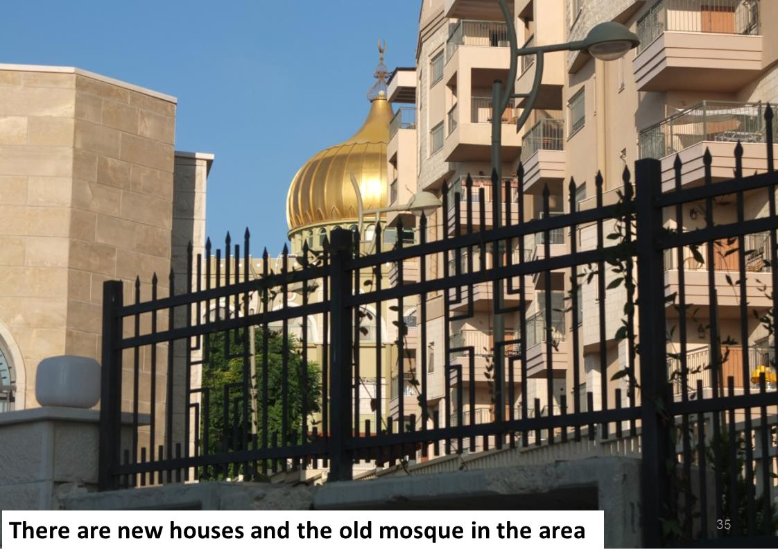 There are new houses and the old mosque in the area 35