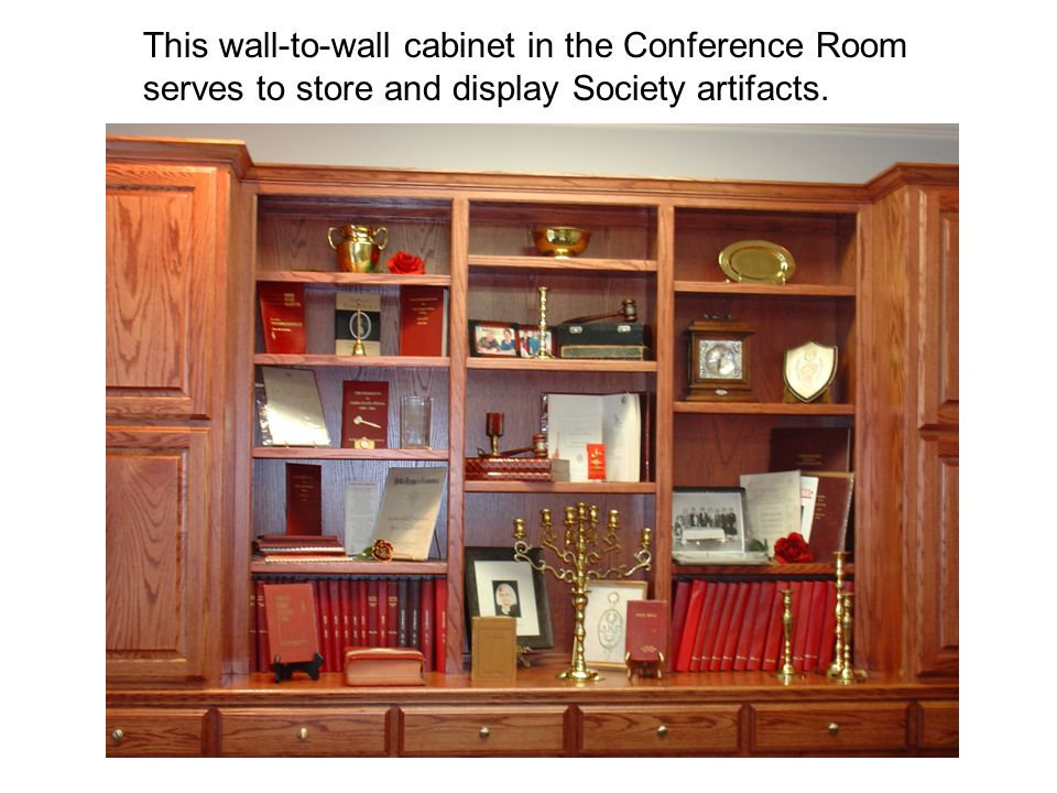 This wall-to-wall cabinet in the Conference Room serves to store and display Society artifacts.