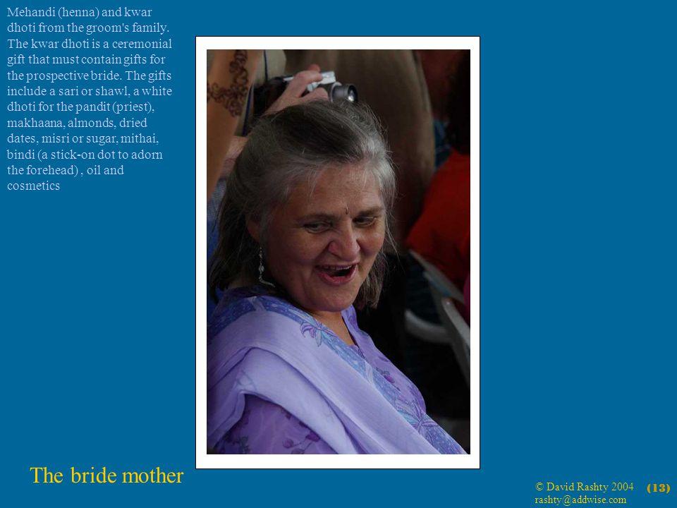 © David Rashty 2004 rashty@addwise.com (13) The bride mother Mehandi (henna) and kwar dhoti from the groom s family.