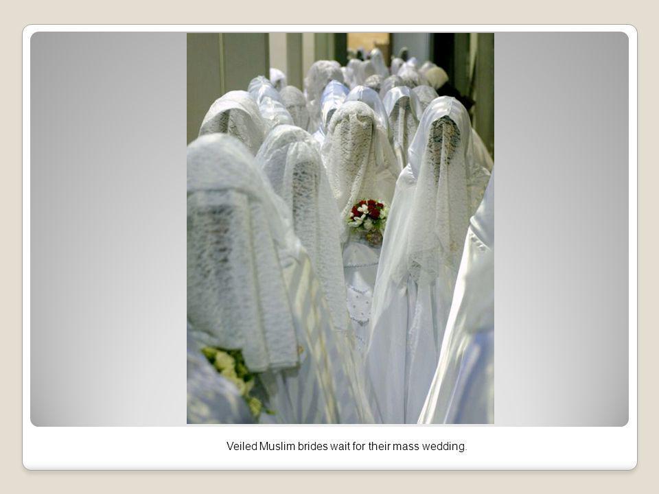 Veiled Muslim brides wait for their mass wedding.