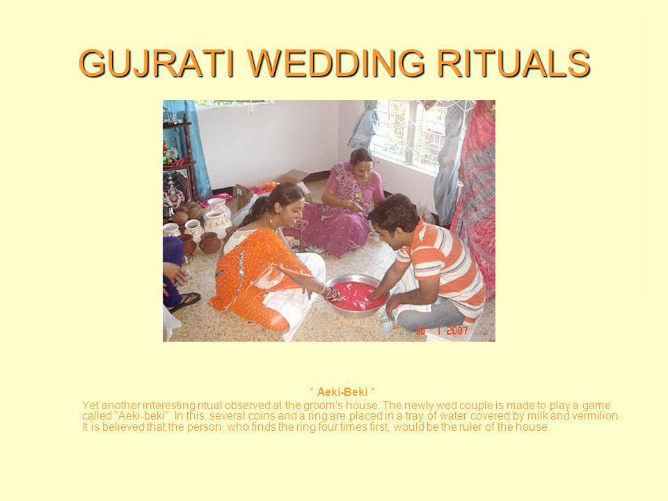 GUJRATI WEDDING RITUALS * Ghar Nu Laxmi * The bride s first step into her new home is considered auspicious.