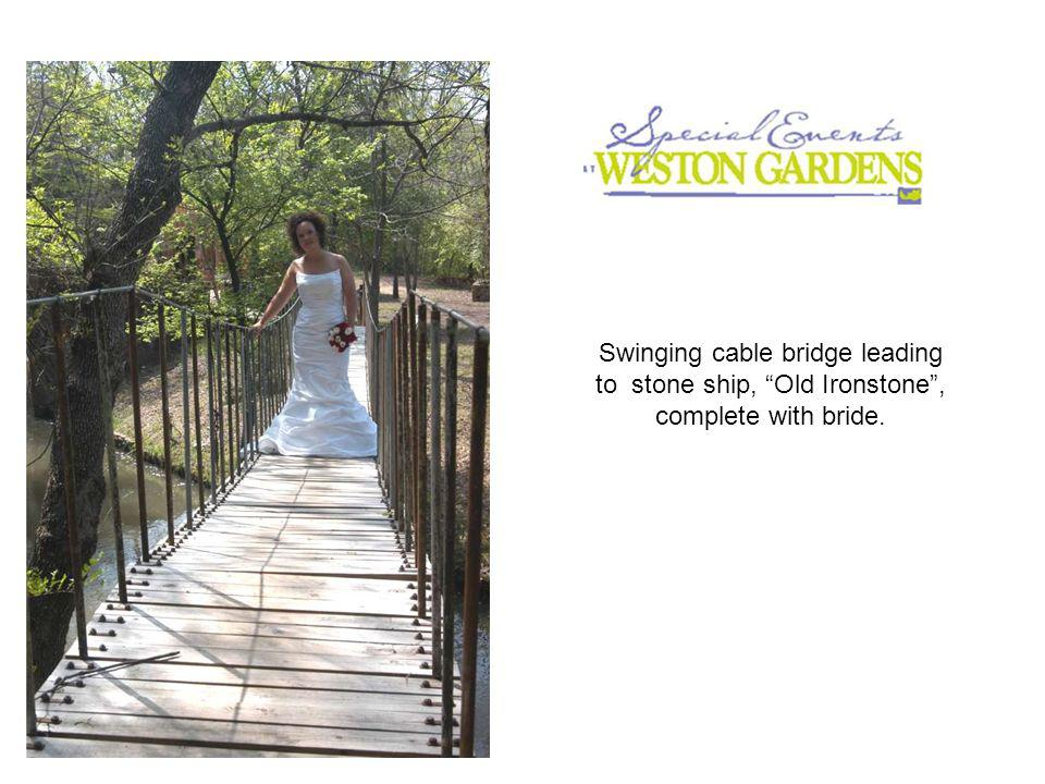 Swinging cable bridge leading to stone ship, Old Ironstone, complete with bride.
