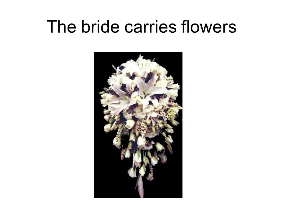 The bride carries flowers