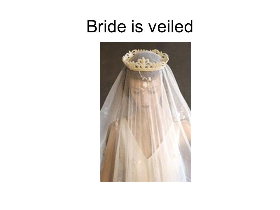 Bride is veiled