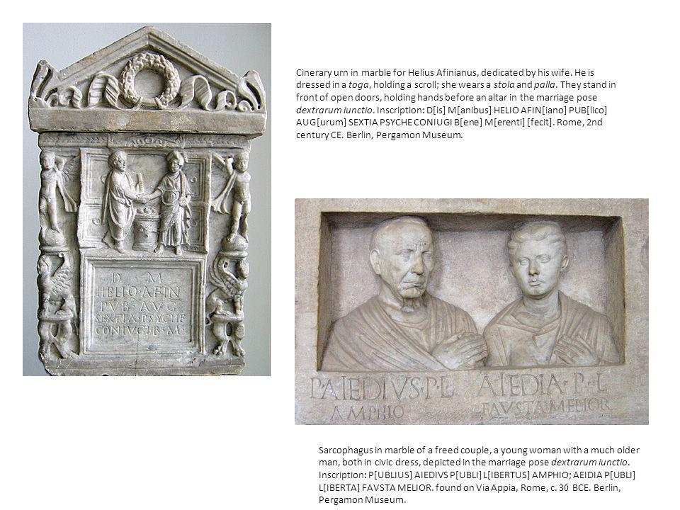 Cinerary urn in marble for Helius Afinianus, dedicated by his wife. He is dressed in a toga, holding a scroll; she wears a stola and palla. They stand