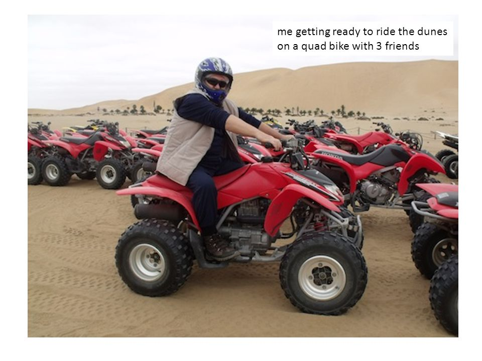 me getting ready to ride the dunes on a quad bike with 3 friends