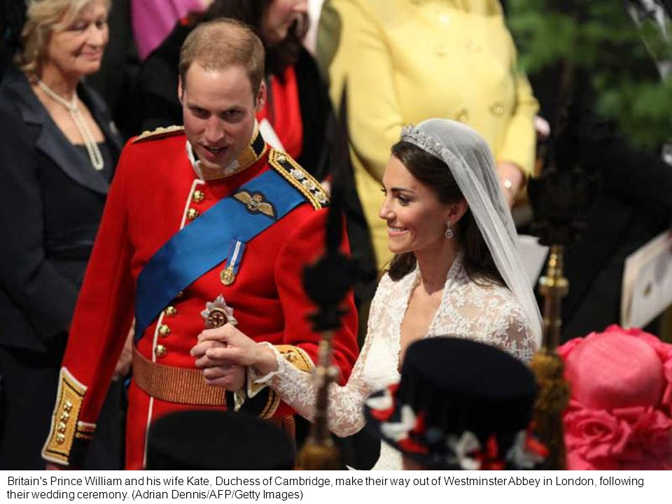 Britain s Prince William places the ring on the finger of his bride, Kate Middleton, as they stand at the altar at Westminster Abbey.