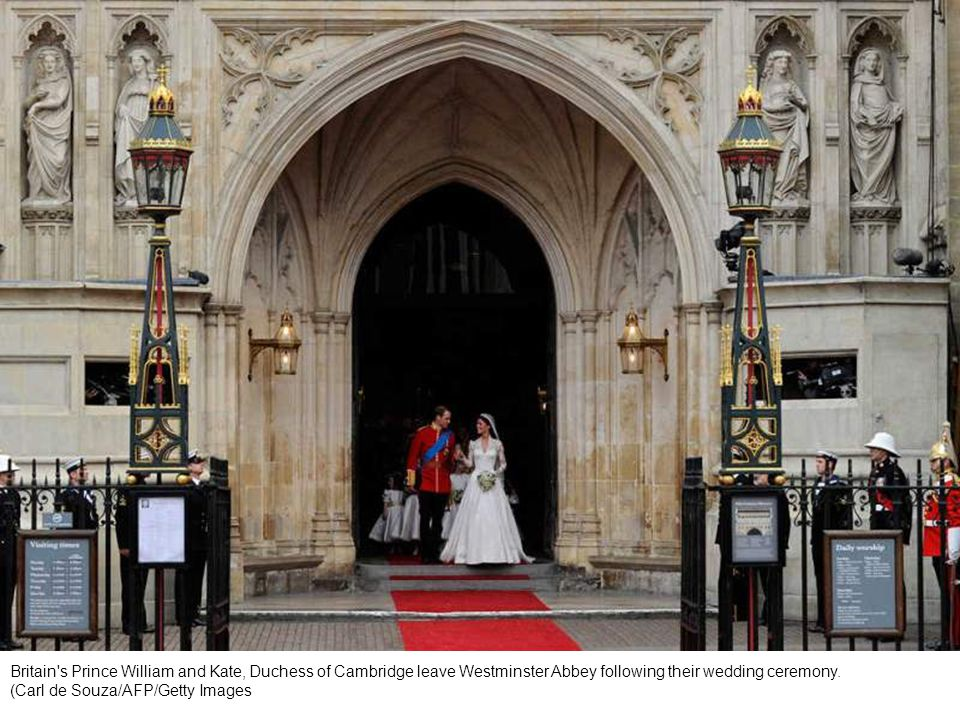 Britain s Prince William and his wife Catherine, Duchess of Cambridge, stand outside Westminster Abbey after their wedding.