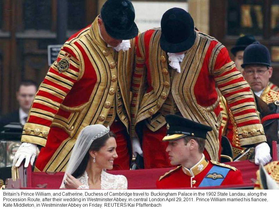 Britain s Prince William, and Catherine, Duchess of Cambridge smile as they travel to Buckingham Palace in the 1902 State Landau, along the Procession Route, after their wedding in Westminster Abbey, in central London April 29, 2011.